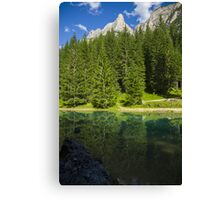 Green alpine lake in the summer and mountain peak in the Alps - Il paradiso verde Canvas Print