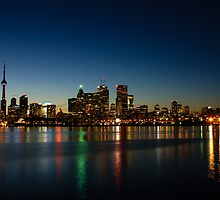 Blue Hour - Toronto's Dazzling Skyline Reflecting in Lake Ontario by Georgia Mizuleva