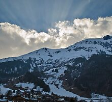 Snowy mountain with sun rays by Chris Martin
