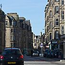 Cars and buildings on a street in Edinburgh by ashishagarwal74