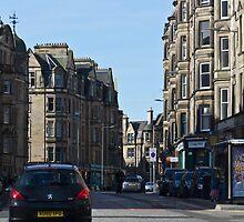 Cars and buildings on a street in Edinburgh by ashishagarwal74