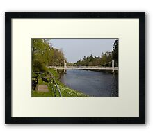 Benches and suspension bridge over River Ness Framed Print