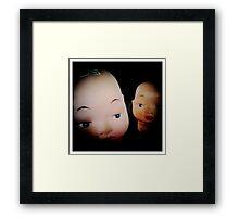 Dolls in Conspiring Framed Print