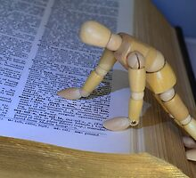 Small Wooden Manikin Using A Dictionary - by Schoolhouse62