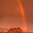 Rainbow over Crescent City harbor by Yves Rubin