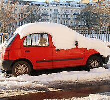 Red car in the snow by David Fowler