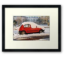 Red car in the snow Framed Print