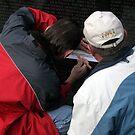 Rubbing A Veteran's Name by Cora Wandel