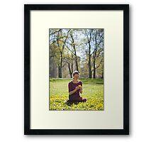 Girl picking flowers Framed Print