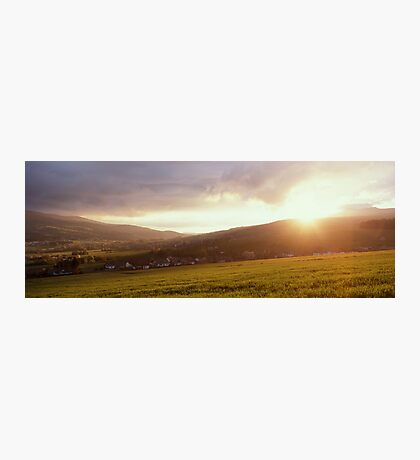 Landscape filled with golden light at sunset Photographic Print