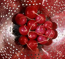 Fresh red radishes in a colander by intensivelight