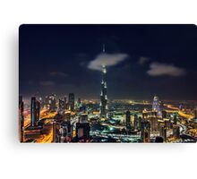 Scattered clouds passing by Burj khalifa and the downtown Dubai Canvas Print