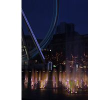 Fountain and big wheel. Photographic Print