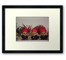 Trolls on a Shelf Framed Print