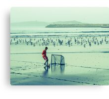Football on the beach Canvas Print