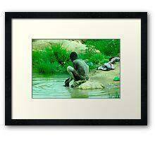 Man bathing in a pond Framed Print