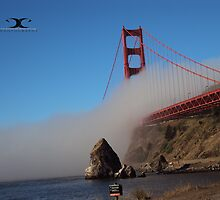 The Marine Layer flowing over the Golden Gate Bridge by 2Canons
