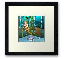 Little Mermaid holding Anemone Flower Framed Print