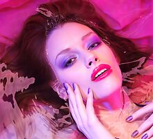 Beauty portrait of woman lying in water with makeup in vivid puple colors art photo print by ArtNudePhotos