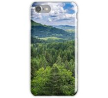 Mountains covered in pine trees iPhone Case/Skin