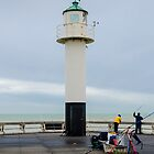 Fishing on the pier of Nieuwpoort, Belgium by 7horses