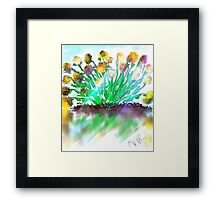 Yellow flowers in sun with water reflection Framed Print