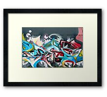 Abstract Graffiti on the brick textured wall Framed Print