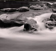 river rocks by Greg McMahon