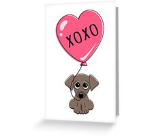 Cute puppy dog holding heart balloon with text XOXO hugs and kisses Valentine's day card Greeting Card