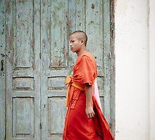 Monk walking in Luang Prabang by DebWinfield