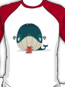 Little cat sitting down to dine on a huge whale T-Shirt