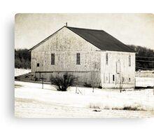 White barn in the white snow Canvas Print
