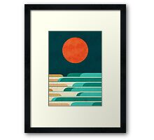 Red moon and chasing waves Framed Print