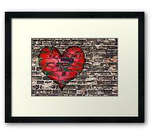 heart on the old broken brick wall Framed Print