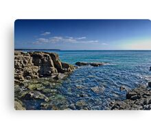 Sea view from rocky cove Canvas Print