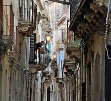 Old street in Siracusa by Arie Koene