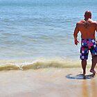 Macho Man...tiptoeing in the cold Atlantic water by Poete100