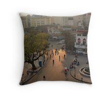 dusk-lit street, hanoi Throw Pillow