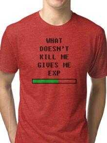 What doesn't kill me, gives me exp (black) Tri-blend T-Shirt