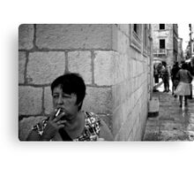 A moment's smoke Canvas Print