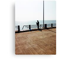 Lonely Man Sitting On Railing By The Ocean Canvas Print