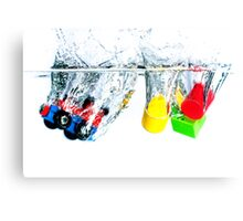 Wooden toys in water Canvas Print