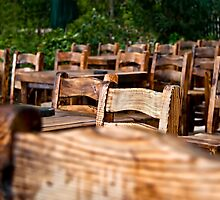 Empty Wooden Chairs and Tables by Kuzeytac