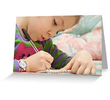 Little Girl Drawing Flowers On A Notebook Greeting Card
