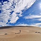 Photographing the photographer photographing the sand dunes with clouds above. by Ian Berry