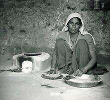 Woman making roti, Ranthambore, India by paulsborrett