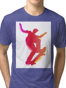 Skateboarder performing a trick Tri-blend T-Shirt