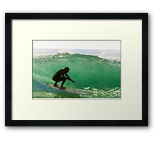 Long boarder surfing the waves at sunset Framed Print