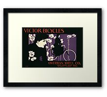 Reproduction of a poster advertising Victor Bicycles Framed Print