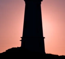 Lighthouse during sunrise in the early morning Sticker